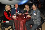 Debbie and Allen Baker, left, sit with Beth and Nick Garvey during the Book of Lists reception at Starbase in Addison.
