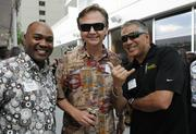 From left, Keenan Porter, Chamber of Commerce of Hawaii, Rob Hienaman, Pacific Edge Magazine and Ron Addington of GEICO