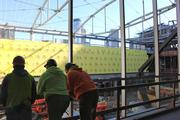 The College Football Hall of Fame hit a construction milestone on Jan. 16. The 94,000-square-foot attraction is set to open in August.