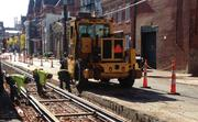 MPD workers check track gauge on Elm Street, north of 14th Street.