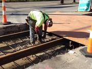 An MPD worker ties resteel on Elm Street, north of Liberty.