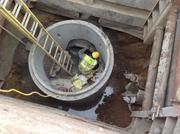 An MPD worker installs a sewer connection at the Maintenance and Operations Facility site.
