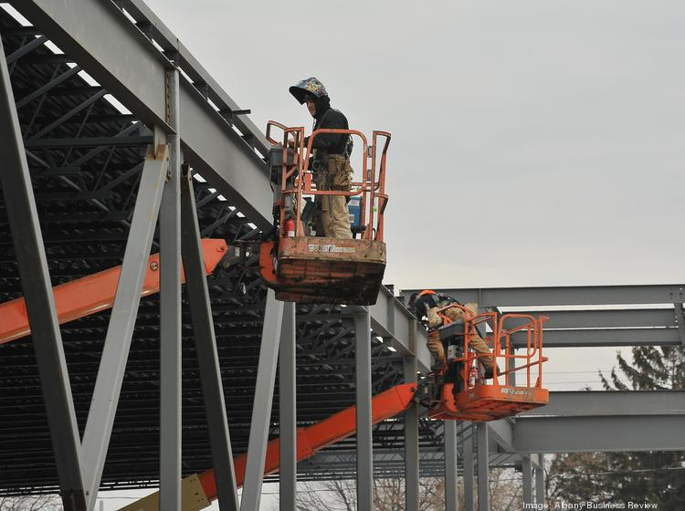Construction crews work on a new Price Chopper supermarket at the site of the former St. Patrick's church site in Watervliet, NY.