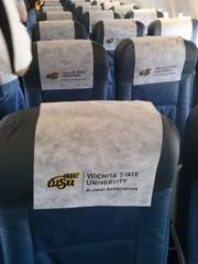 The fans' charter plane to Atlanta had Wichita State logos on the seats.