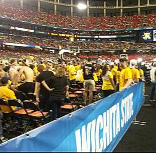 Fans are awaiting the start of the Final Four game between the Wichita State Shockers and the University of Louisville Cardinals.