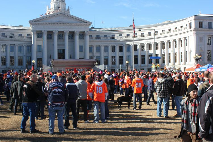 Hundreds of Denver Broncos fans gather in front of the Denver City and County Building for a team rally Jan. 17.