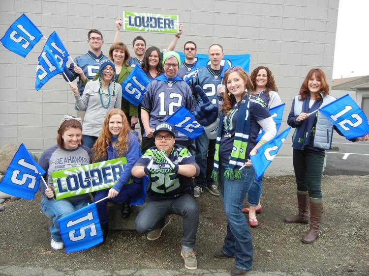 Issaquah-based Artitudes Design's employees got rowdy to show their 12th Man spirit on Blue Friday.