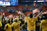 Shocker fans hold up their seat covers to throw off a Louisville foul shooter.