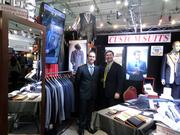 Owner Gus Zistas and Dan Baum man the Brothers Tailors booth at Barrett-Jackson.