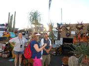 Owners Jenny and Chris Smith chat with a customer at the Desert Gardens Nursery booth.