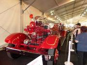 A 1936 Ahrens Fox fire engine joins classic cars at Barrett-Jackson.