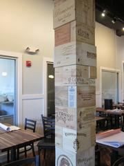 Wood from wine crates dots the bar as well as the pillars in the restaurant.