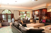 The home has spacious, casual living areas in addition to formal spaces.