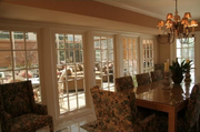 The sun room is off the informal dining room and kitchen.