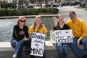 Shocker fans grab a seat while waiting for the doors of the nearby Geogria Dome to open for Saturday's games.