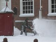 Good times of yore: A National Park Service worker runs a snowblower outside Independence Hall in a 2010 blizzard.