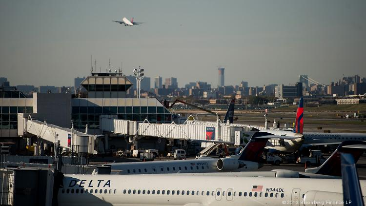 Delta Air Lines Inc. planes sit on the tarmac at LaGuardia Airport.
