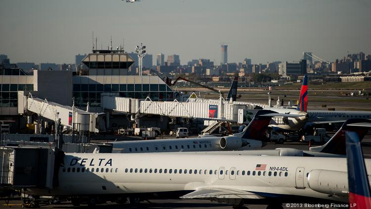 Delta Air Lines Inc. planes sit on the tarmac at LaGuardia Airport