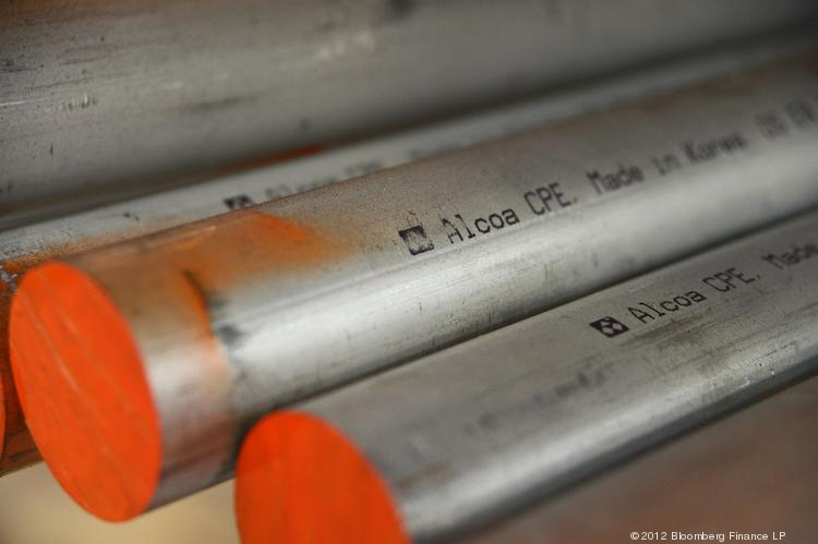 Aluminum rods displaying the Alcoa Inc. logo are stored at the Highett Metal Pty Ltd. warehouse in the suburb of Braeside in Melbourne, Australia, on Friday, June 29, 2012.