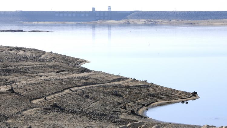 """A view of water at Folsom Lake at record low levels in January. Gov. Jerry Brown says his $6 billion water bond plan """"provides for water use efficiency and recycling, effective groundwater management and added storage."""" He contends a $11 billion water measure on the November ballot is """"pork laden."""""""