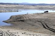 More mud and a dry lake bed is exposed at Folsom Lake, as seen from Granite Bay.