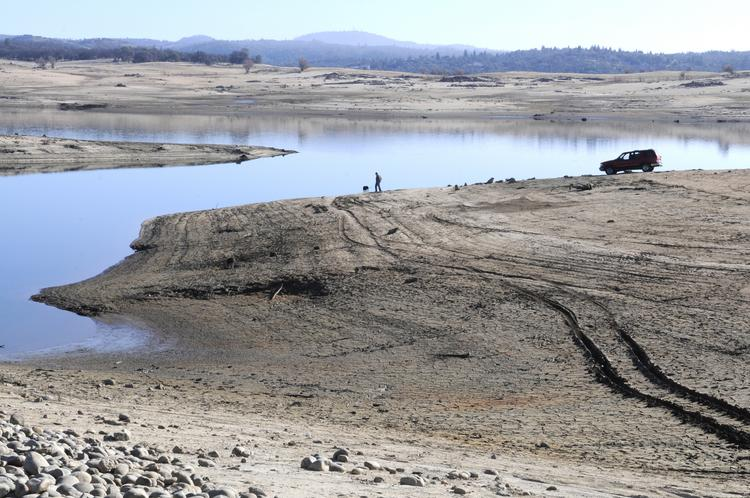 More mud and dry lake bed is exposed at Folsom Lake, as seen from Granite Bay in mid-January. After several days of rain, the lake's water level has risen several feet, but water officials are not celebrating yet.