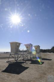 Lifeguard towers at Granite Beach are far away from water at Folsom Lake.