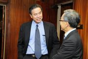 Sen. Clayton Hee, left,  talking with Public Safety Director Ted Sakai.