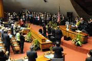 Hawaii lawmakers applaud Gov. Neil Abercrombie during his State of the State address on Tuesday.