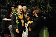 Gov. Neil Abercrombie was draped with lei for his state of the state speech.