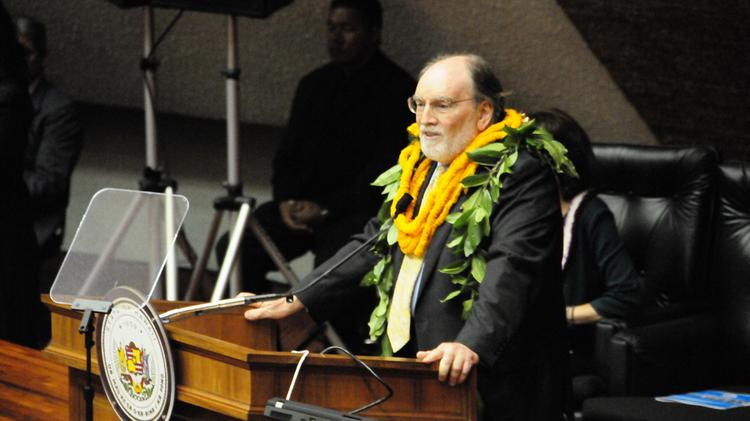 Gov. Neil Abercrombie, seen in this file photo at the 2014 State of the State Address, said he will allow a bill that expands the number of state boards and commissions that require public financial disclosure statements of board members to become law without his signature.