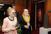 Gov. Neil Abercrombie and his wife, Nancie Caraway, are escorted by security to the House Chambers.