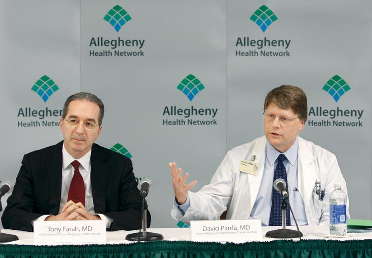 David Parda, MD, right, Chair of the Allegheny Health Network Cancer Institute, answers a reporter's question Wednesday after it was announced that the Allegheny Health Network and the Johns Hopkins Kimmel Cancer Center have signed a memorandum of understanding to seek to establish a formal affiiation between the two parties.  At left is Tony Farah, MD, chief medical officer of the Allegheny Health Network.