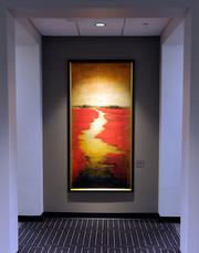 Art adorns the walls of Country Club Bank's new headquarters at One Ward Parkway. Several pieces were acquired during a benefit auction for the victims of the gas explosion at JJ's Restaurant.