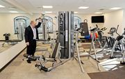 CEO Paul Thompson inspects equipment in the exercise room at Country Club Bank's new headquarters at One Ward Parkway.