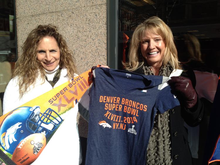 "Becky McClintock, 46, of Parker and Lori Borelli, 54, of Denver stocked up to ""Decker-ate"" their downtown Denver office Wednesday. They were playing off Denver Broncos wide receiver Eric Decker's name."