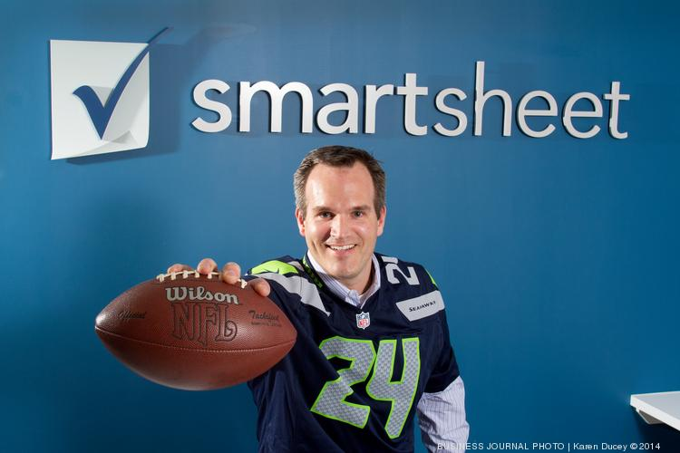 Mark Mader, CEO of Smartsheet, at the company offices in Bellevue. His company  developed software to coordinate logistics at the Super Bowl.