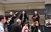 There was even a band serenading guests on their way to the exhibitor floor. Classy.