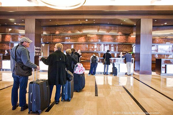 Guests check into the Omni Nashville Hotel, the 854-room headquarters hotel for Music City Center.