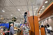 A crew from Pradco Outdoor Brands breaks down their booth at Music City Center after the Archery Trade Association convention in January, which drew about 8,000 people.