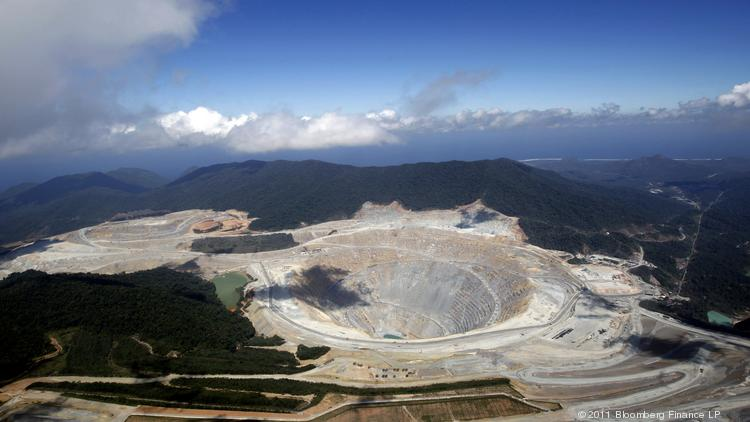 An aerial view shows an open pit at the Batu Hijau copper and gold mine operated by PT Newmont Nusa Tenggara in Sumbawa, West Nusa Tenggara province, Indonesia.