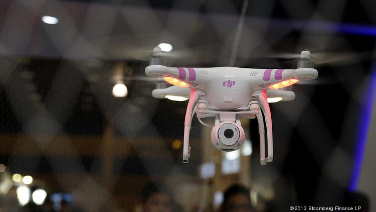The DJI Phantom drone is demonstrated at the Dajiang Innovation Technology Inc. booth during the 2014 Consumer Electronics Show (CES) in Las Vegas Jan. 9.