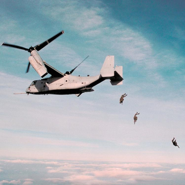 OSPREY IN ACTION Paratroopers exit a USMC MV-22 during flight.