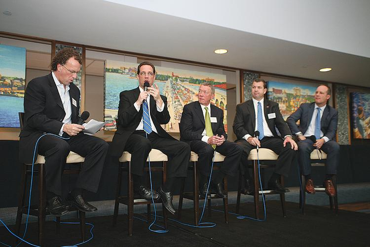 From left, SportsBusiness Journal Executive Editor Abe Madkour moderates a panel with Rays Senior VP Mark Fernandez, USF Athletic Director Doug Woolard, Buccaneers COO Brian Ford and Lightning COO Steve Griggs.