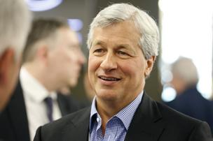James 'Jamie' Dimon, chief executive officer of JPMorgan Chase & Co., speaks with delegates during a break in sessions on the opening day of the World Economic Forum (WEF) in Davos, Switzerland, on Wednesday, Jan. 22, 2014. World leaders, influential executives, bankers and policy makers attend the 44th annual meeting of the World Economic Forum in Davos, the five day event runs from Jan. 22-25.