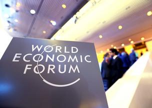 A logo sits on a sign inside the Congress Center on day two of the World Economic Forum (WEF) in Davos, Switzerland, on Thursday, Jan. 23, 2014. World leaders, influential executives, bankers and policy makers attend the 44th annual meeting of the World Economic Forum in Davos, the five day event runs from Jan. 22-25. Photographer: Chris Ratcliffe/Bloomberg