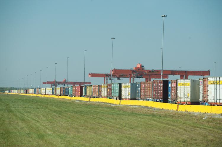 Giant cranes are used pick up containers and move them from train to truck at the BNSF Railway Intermodal Facility, which is surrounded by Logistics Park Kansas City.