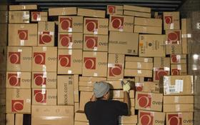 A worker loads orders on to a United Parcel Service Inc. (UPS) truck at the Overstock.com Inc. distribution center in Salt Lake City, Utah, U.S., on Tuesday, December 18, 2012.