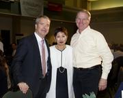 Five Star Bank president and CEO James Beckwith, Sacramento Asian Pacific Chamber CEO Pat Fong Kushida and Buzz Oates Group of Cos. chief financial officer Mike Stodden pose at the Sacramento Business Review.