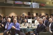 People watch speakers at the Sacramento Business Review.